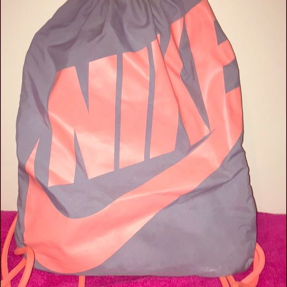 Nike drawstring gym bag Pink and gray Nike drawstring gym bag. Does show  light wear on the swoosh. Nike Bags Backpacks 33f62b60f3318