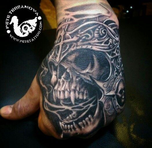 Armored skull hand tattoo black and gray realism