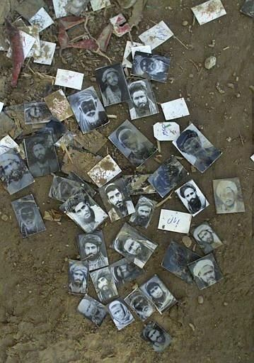 Identity pictures of detainies are scattered on the ground of a Kuduz, Afghanistan jail, Tuesday, Nov. 27, 2001, one day after the city fell from Taliban control to the hands of northern alliance forces. All prisoners detained in the jail were released by northern alliance forces. (AP Photo/Jerome Delay)