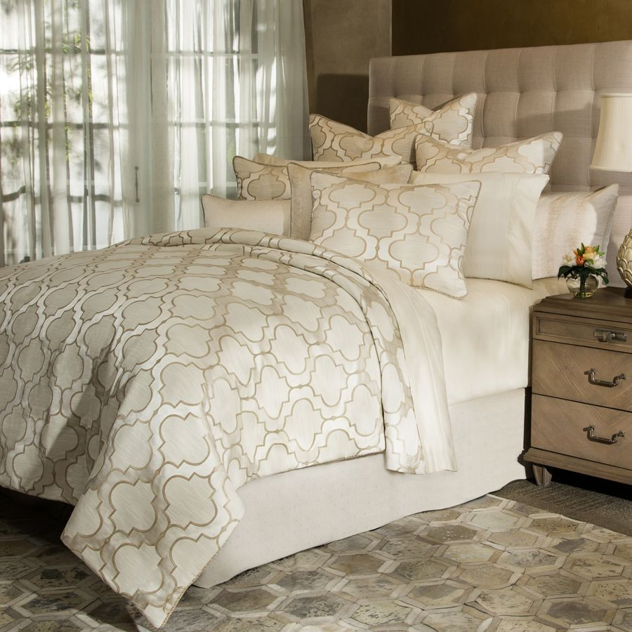 the spectrum comforter collection by michael amini signature bedding features a neutral color palette and an
