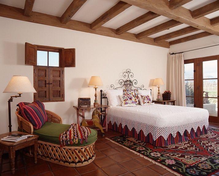 Ann james interior design style mexican hacienda home for Spanish style window shutters