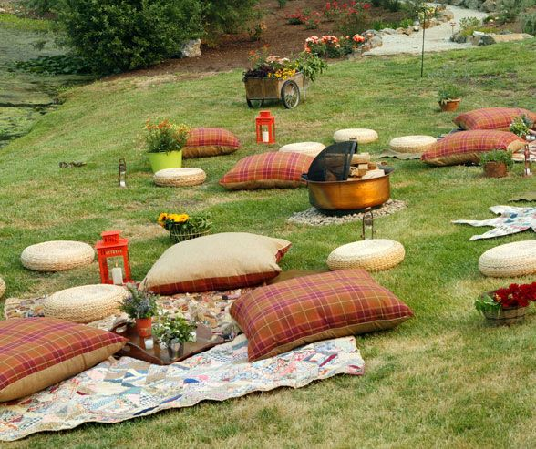 Blankets and throw pillows are scattered around a firepit blankets and throw pillows are scattered around a firepit creating a cozy outdoor lounge area summer wedding decorationscool junglespirit Choice Image