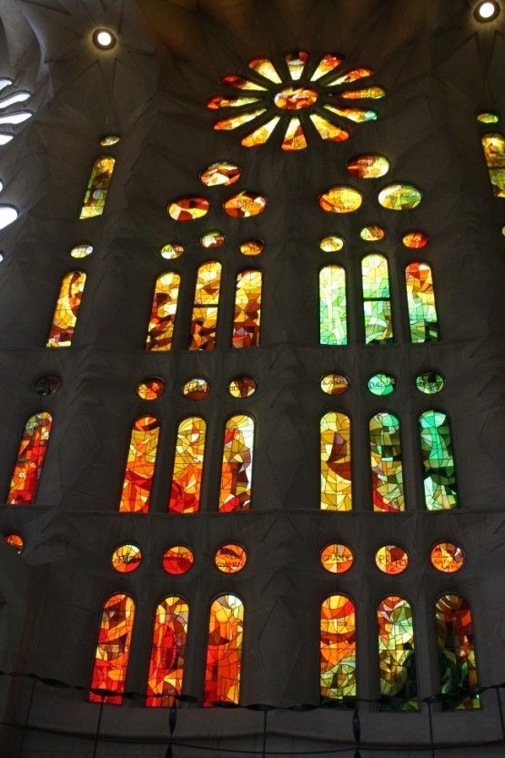 Inside photos of stained glass window in the La Sagrada Familia Cathedral with very organic architecture by Architect Antoni Gaudi