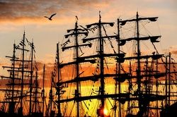 The sun rises over the Tall Ships moored at Hartlepool Marina at the end of the second and final race, from Kristiansand, Norway.