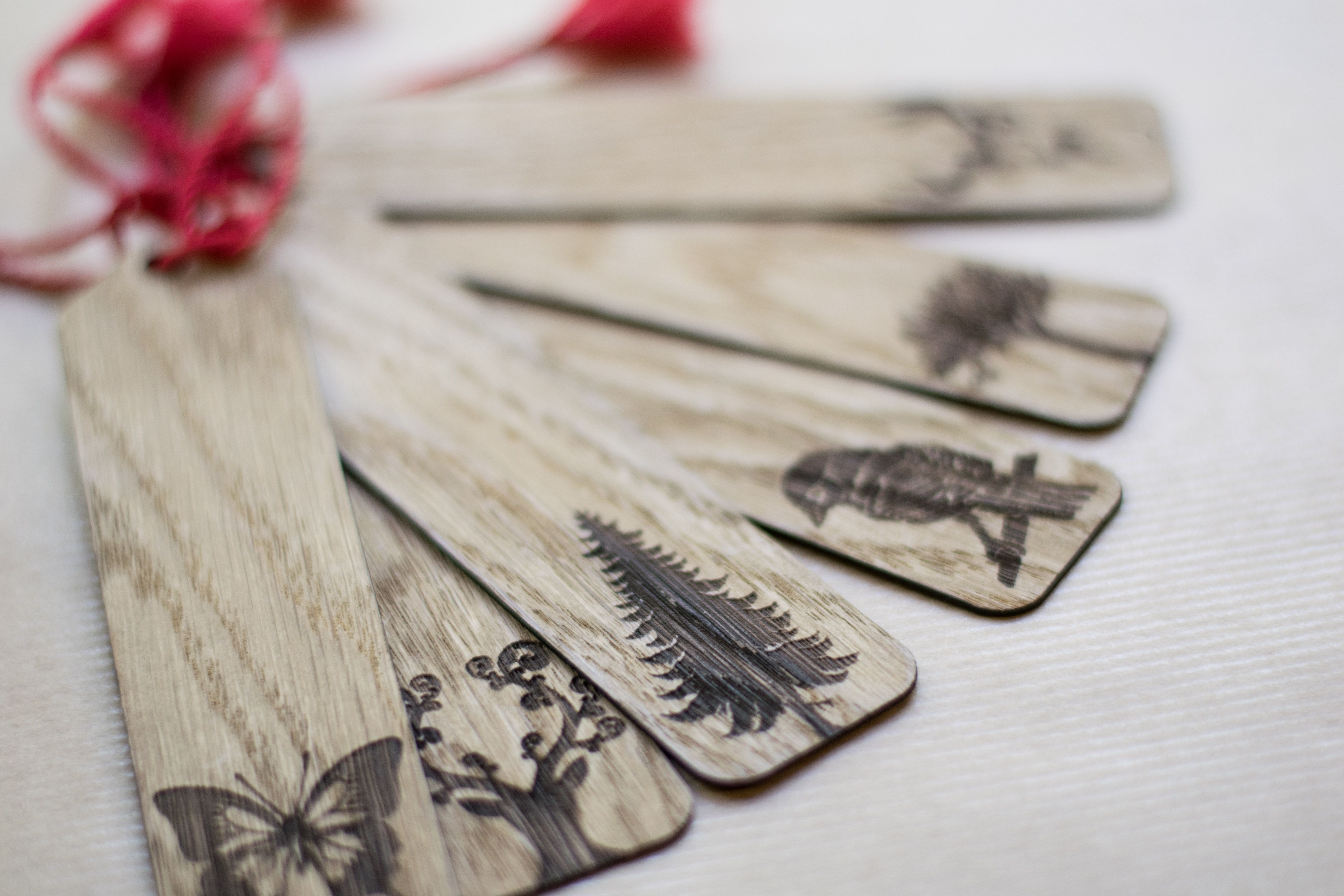 Beautiful oak tree bookmarks with laser engraved silhouettes of nature.