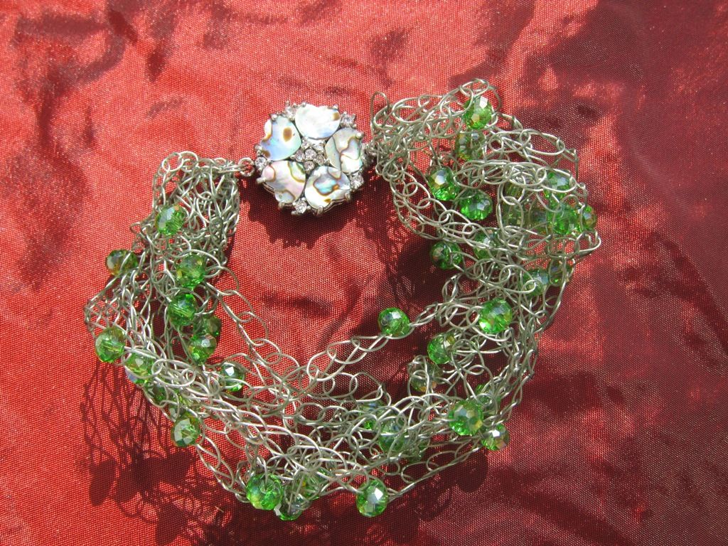 Beautiful handmade bracelets will color your day. This beautiful bracelet with mother-of-pearl. The harmonious dark-green color shades reflect growth, health, and vibrancy. Find more by visiting:   www.red-signaturegifts.com  It costs: $20.99