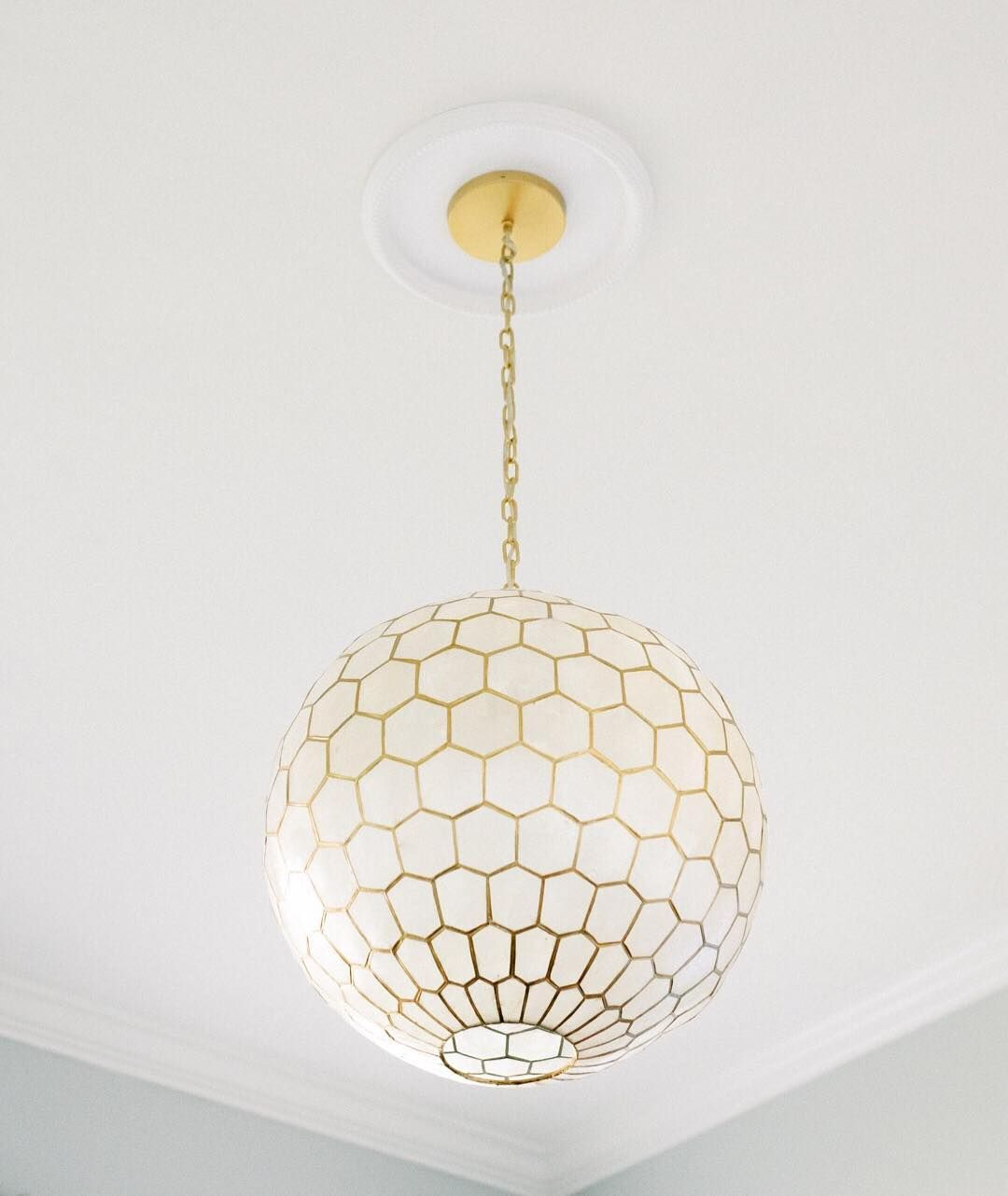 "When we started fixing up our living room, I searched and searched and searched for a light fixture. Lusted after this one but was determined not to break the bank. Months later my husband informed me that lights and bath fixtures are both expensive and it wasn't ""actually that bad."" So I ordered the light fixture and now I have an out for my expensive taste in patinaed brass shower heads and knobs. Give me an inch, you guys."