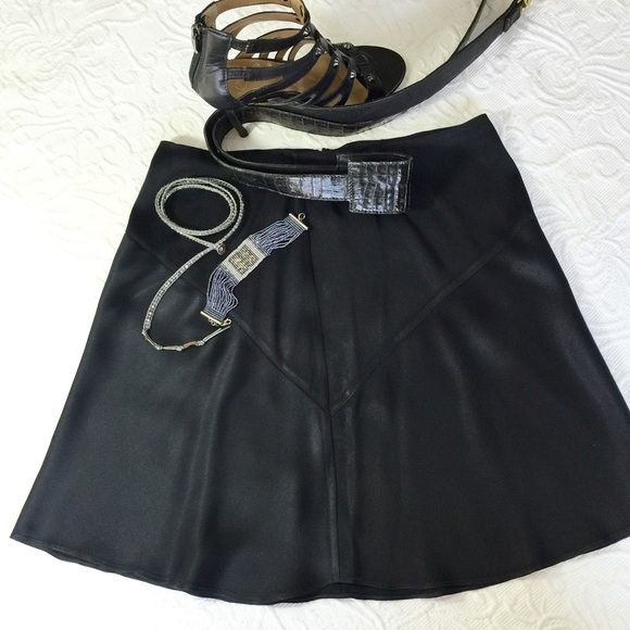 "Sexy Black Satin Skater Skirt RALPH LAUREN Size:10 Sexy feminine black satin skater skirt. Ralph Lauren Black Label. Back zip. Excellent condition. Waist 14"" Length 17.5"" Ralph Lauren Skirts Circle & Skater"