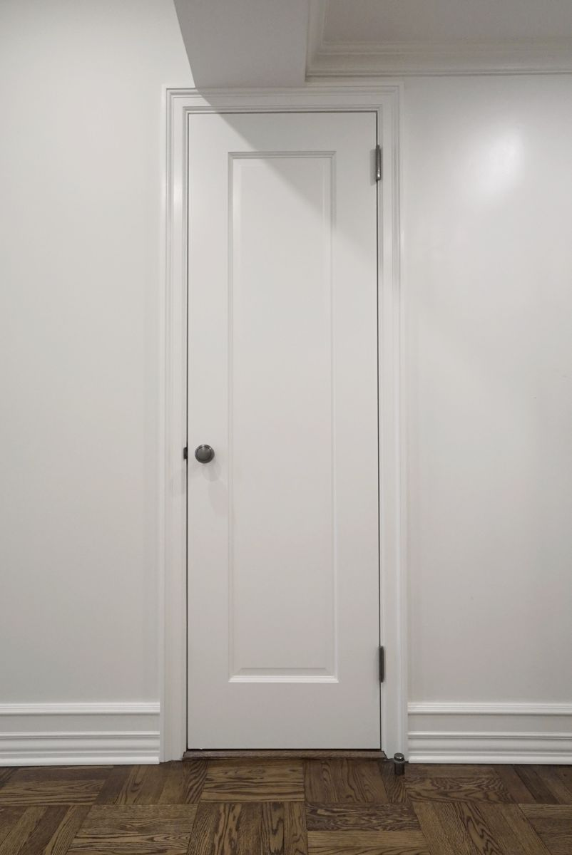 Custom closet with refinished wood flooring throughout
