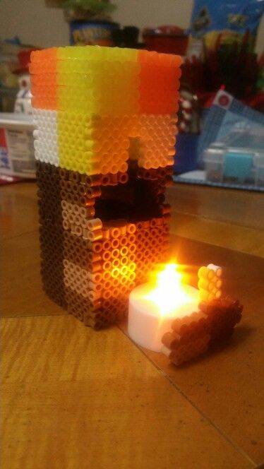 Minecraft tourch 3d perler beads lights the way with a t-light and hidden door to turn it on and off!!!