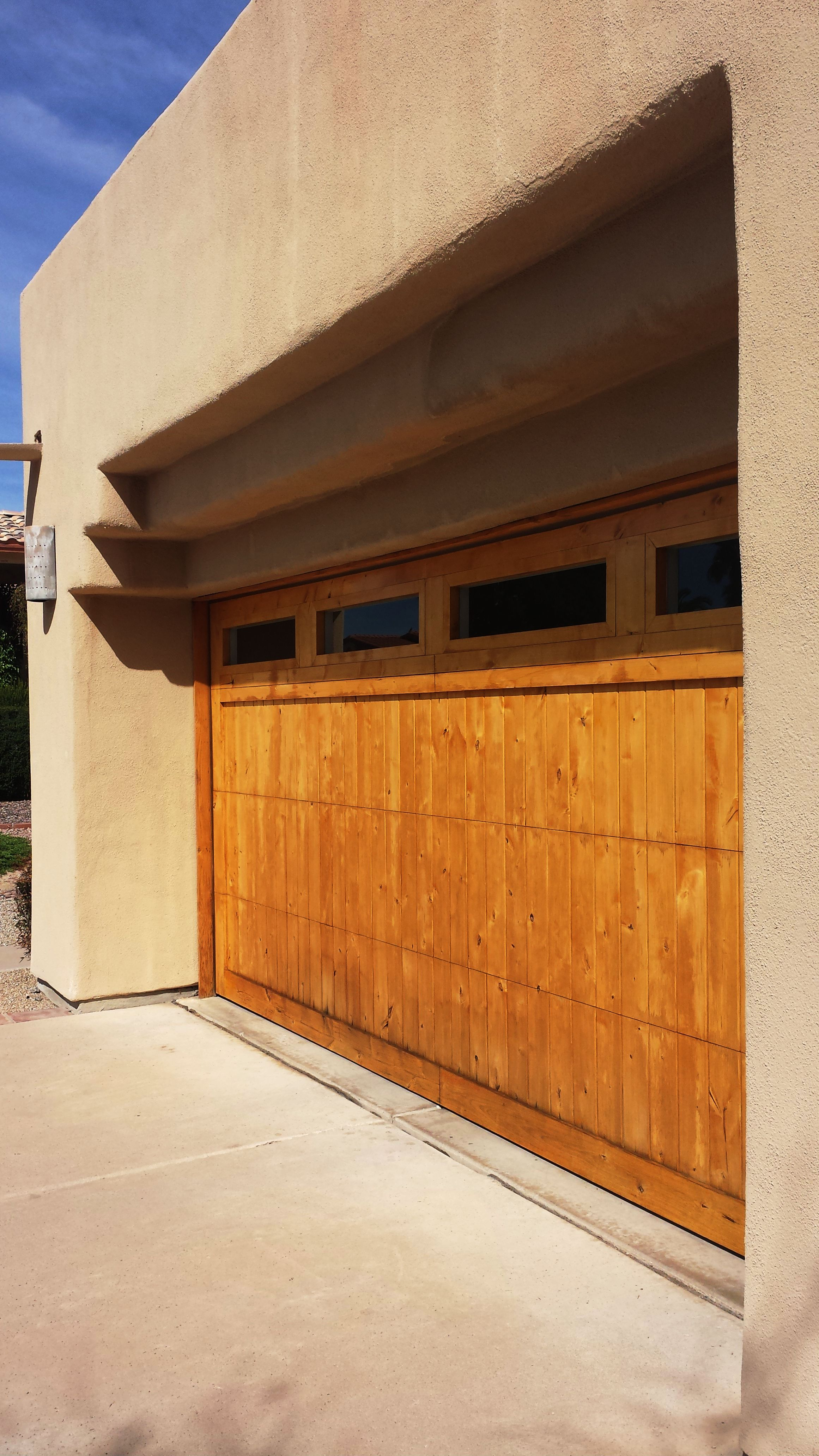 Refinishing Wooden Garage Door.
