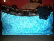 My new Thirty-one skirt turquoise purse, with my small black rose attached. LOVE it!