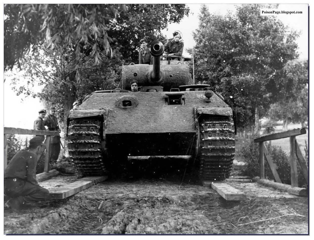 """Men of the 5th SS """"Viking"""" Division manoeuvre a Panther tank over a wooden bridge. Location: Somewhere in the Eastern Front."""