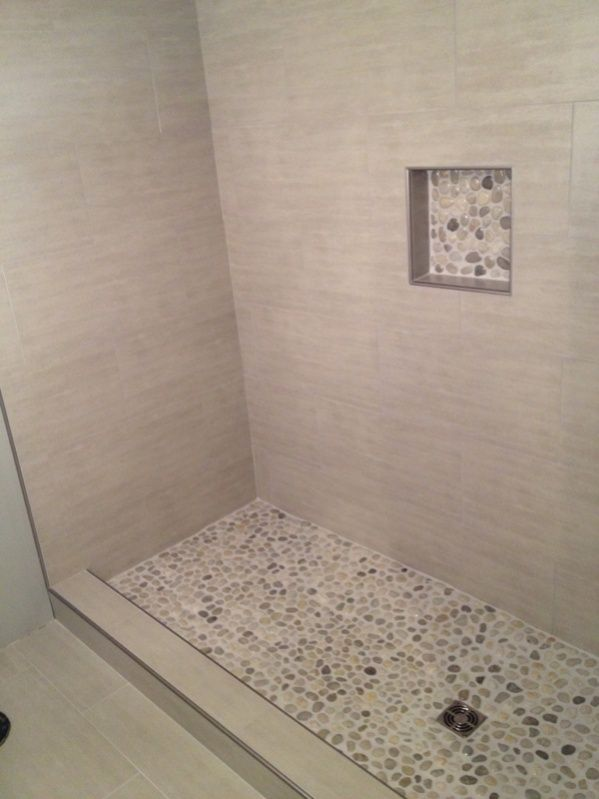 Pebble stones for a shower floor inspiration  Bathroom