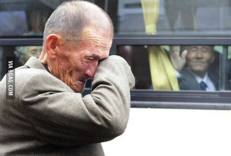 A North Korean waves at his South Korean brother after inter-Korean temporary family reunions