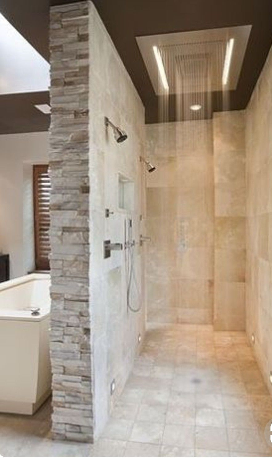 Shower With Two Entries Walk Through No Glass Doors Rain Head In Ceiling And Shower Heads And Body Sprays For Dream House Bathrooms Remodel Dream Bathrooms