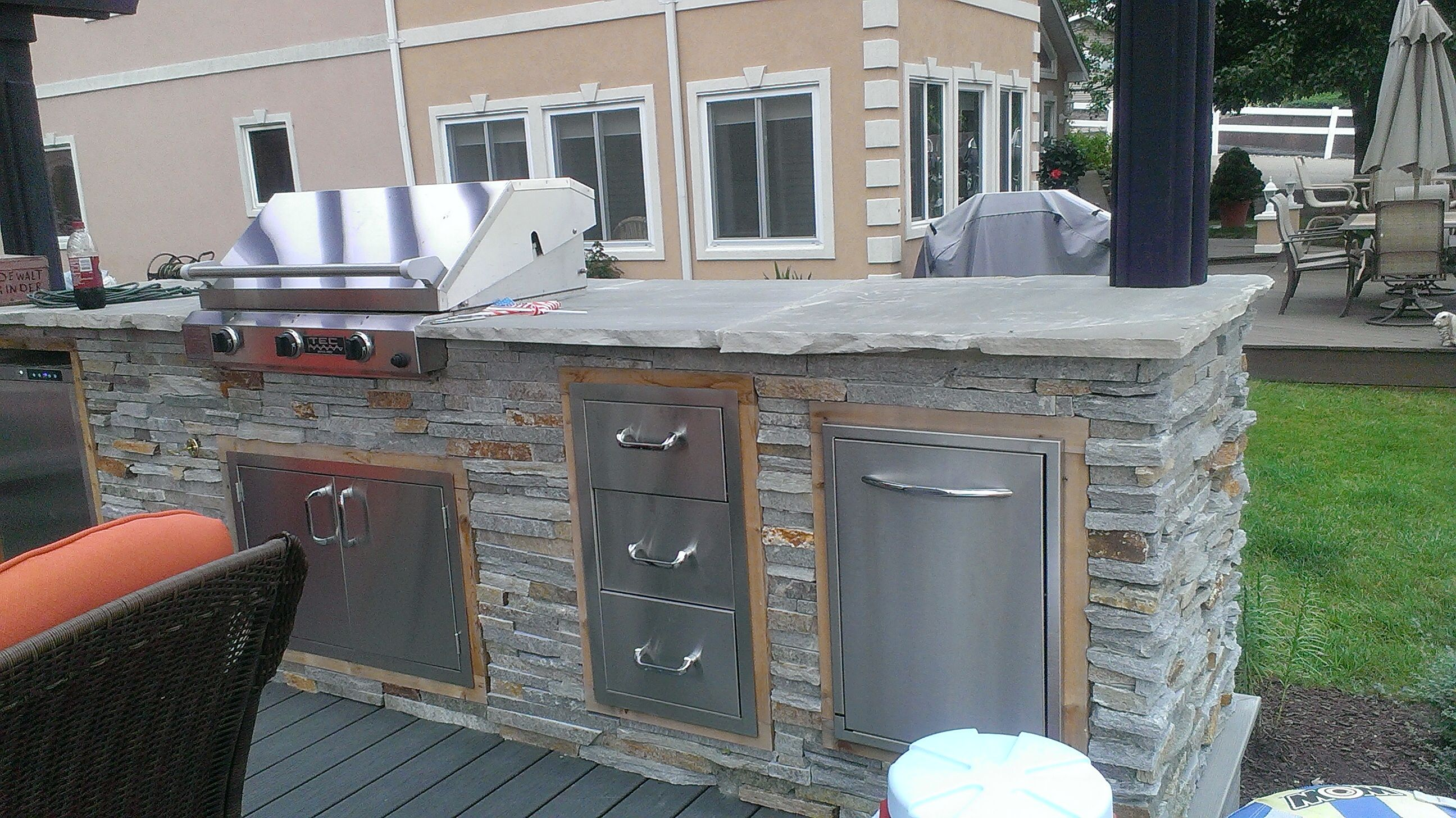 outdoor kitchen at a lake home natural stone veneer matching posts front side natural stone on outdoor kitchen natural id=18076