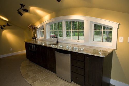 i like how the wet bar is tiled but the room is carpeted on smart man cave basement ideas id=24587