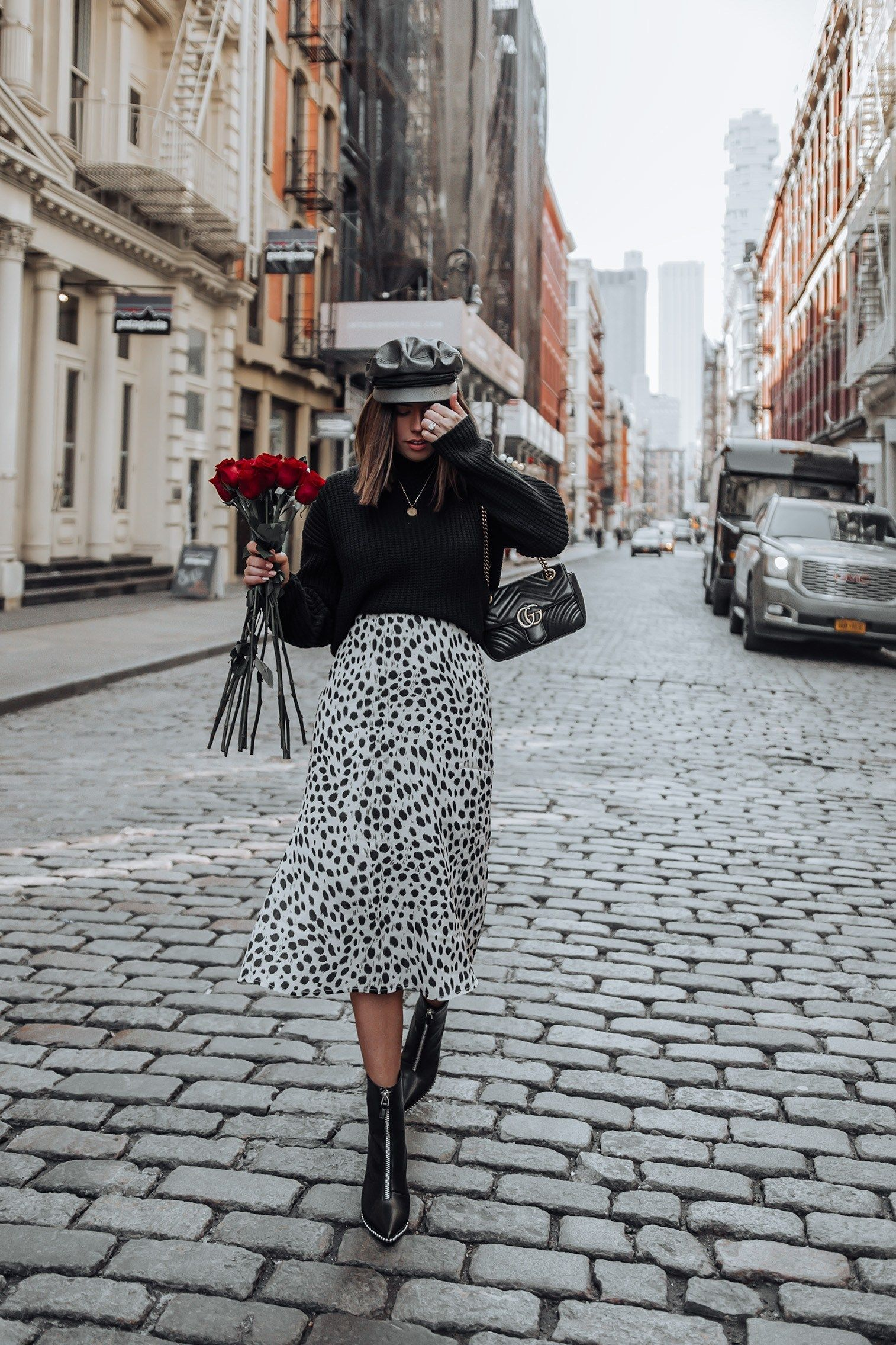 Cheetah spot skirt  Booties  Gucci Bag  Sweater Happy hump day babes I shot this look on Valentines Day last week and Im so excited to finally share it here on the blog T...