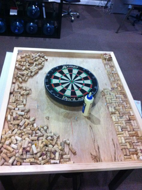 custom dart board frame with wine cork backing located in our design studio for brainstorming. Black Bedroom Furniture Sets. Home Design Ideas