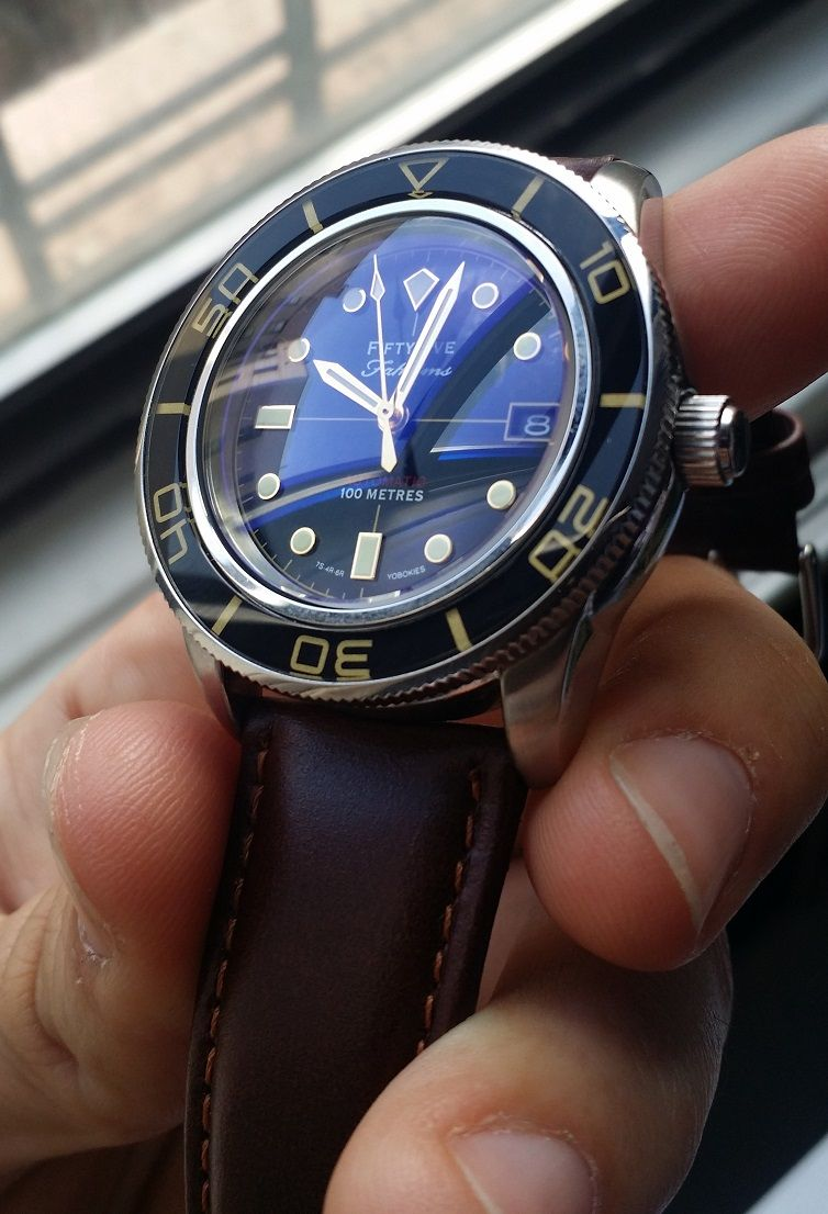 Modded Seiko SNZH57 with sapphire crystal with blue inner AR coating