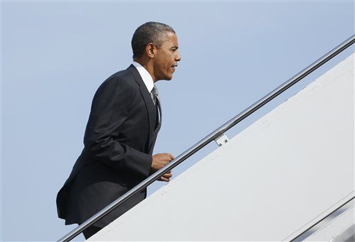 #4 9/17/12 President Barack Obama boards Air Force One, Monday, Sept. 17, 2012, at Andrews Air Force Base, Md., en route to Ohio.  Associated Press