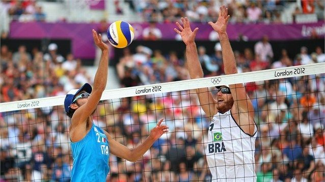 Alison Cerutti of Brazil blocks Daniele Lupo of Italy during the men's Beach Volleyball preliminary match between Brazil and Italy on Day 6 of the London 2012 Olympic Games at Horse Guards Parade