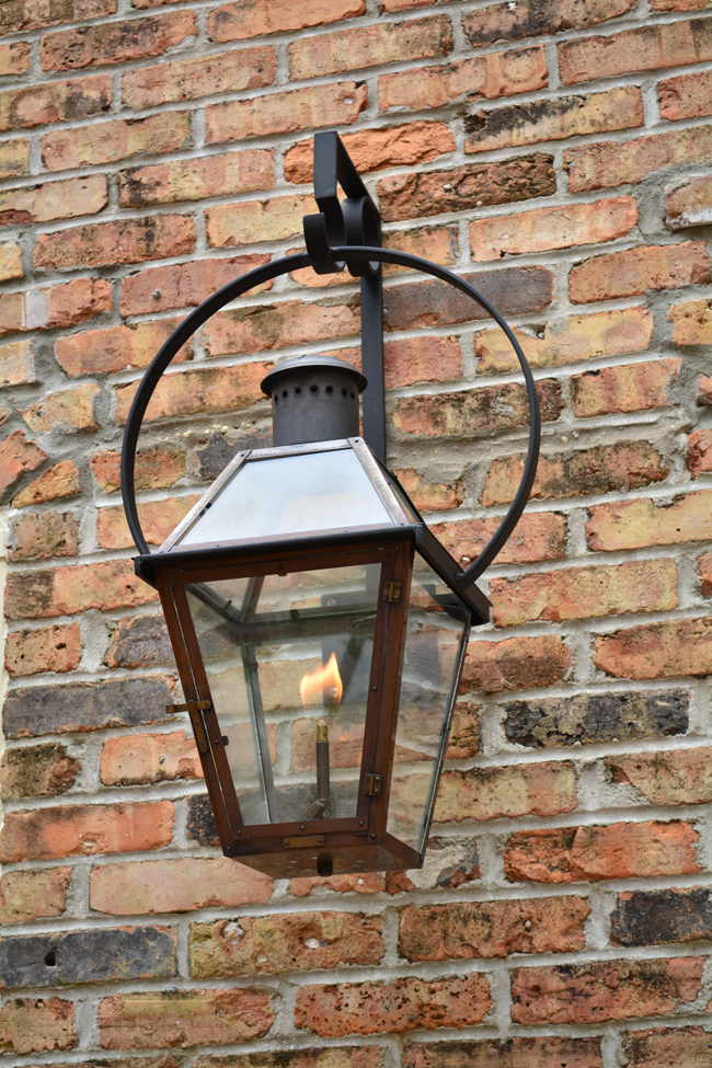 Flickering Bevolo Gas Lanterns Add A Soft Romantic Glow Bevolo Pool House Lanterns And Patio Lights Add Soft Porch Lighting Gas Lanterns French Doors Exterior