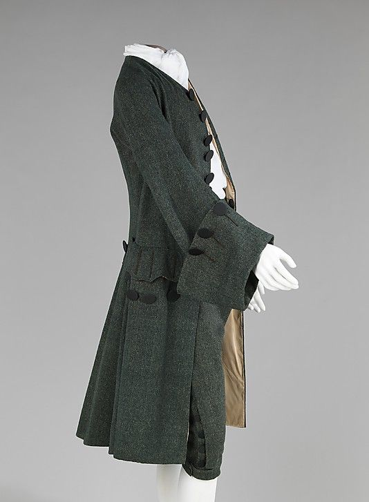 Suit, wool, silk, 1755-65, British. The British aesthetic during the 18th century tended to veer away from the ostentatious French styles being worn at the same time. This particular British suit is exemplary of popular dress in England during the middle of the 18th century with its somber wool, minimal decoration and plain buttons.