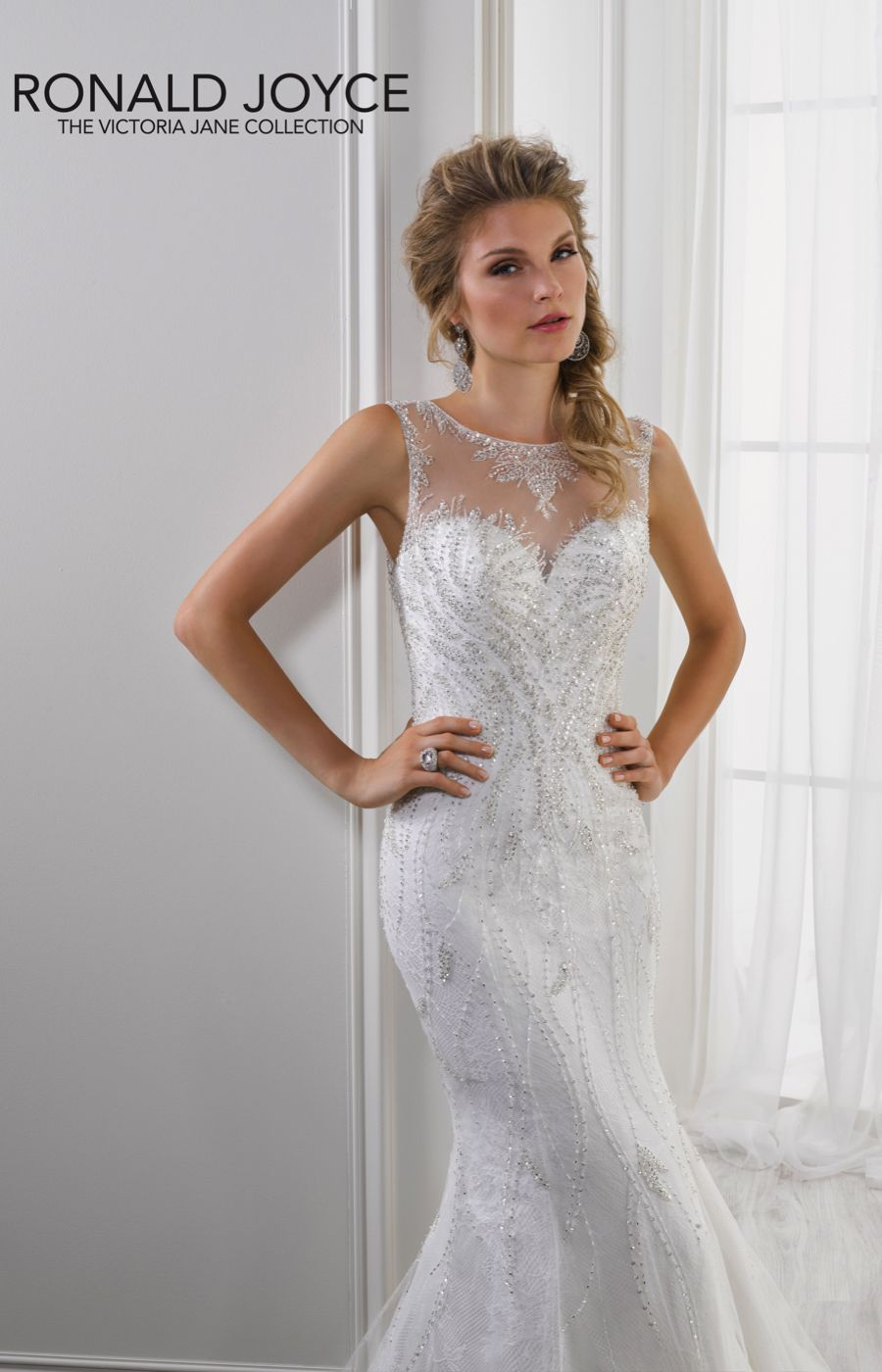 ae0fa6c9180bc Sleeveless tulle over satin fishtail gown with all-over beading detail,  illusion neckline and illusion back. #wedding #dress