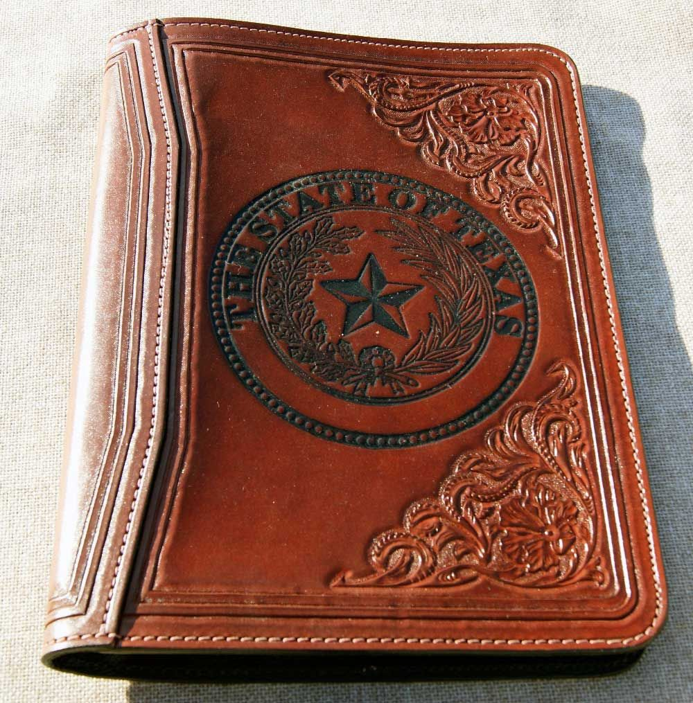 85 photograph of handtooled leather purses bags and