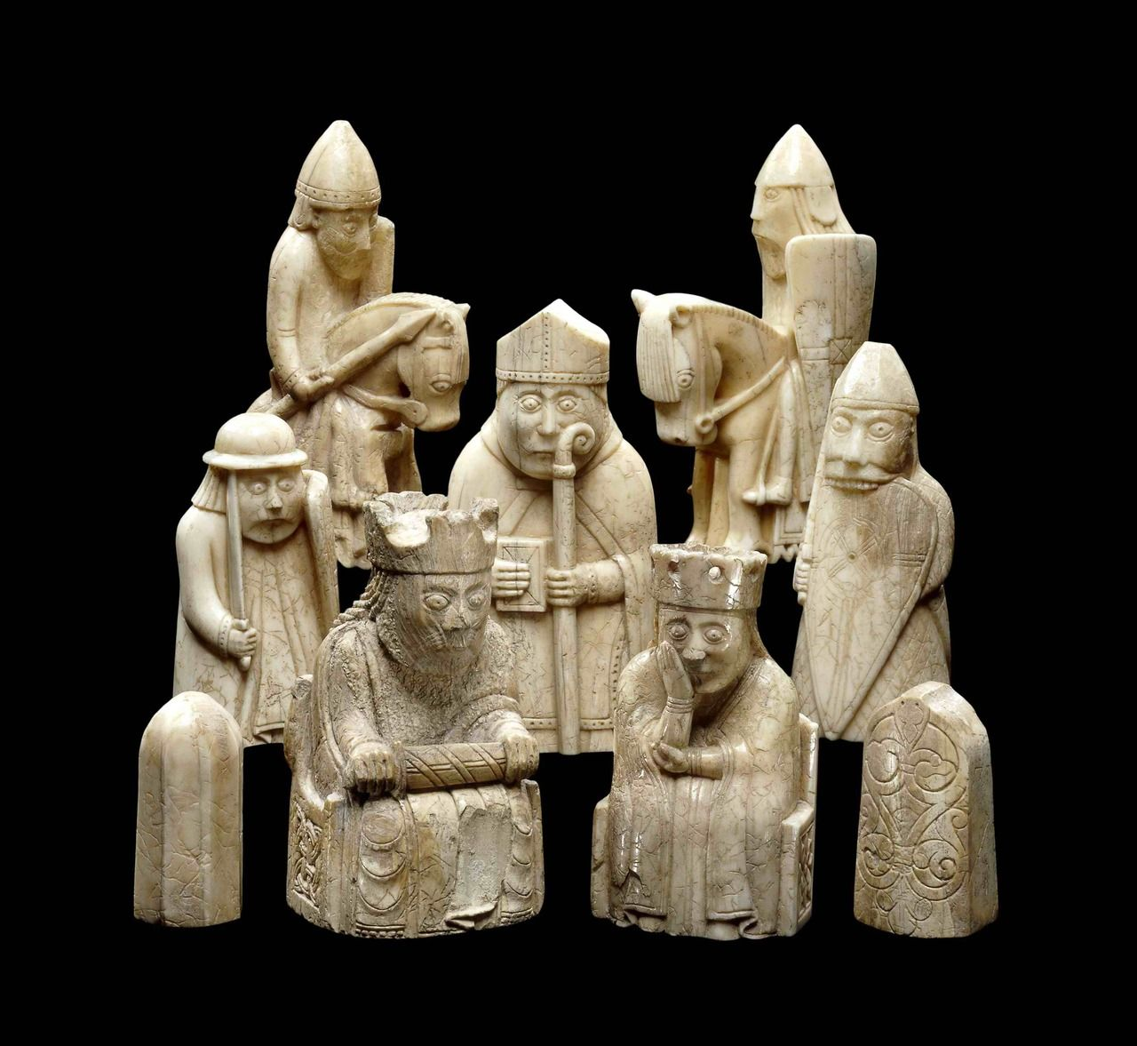 wotanklan: Some of the Lewis Chessmen. Found on Isle of Lewis in the Outer Hebrides/Scotland. These are crafted out of ivory walrustusks, and are dated to the the12'th century. Originally they probably consisted of ivory white and (painted) red sets, to distinguish the pieces from one another when playing, of course. Despite the obvious Christian traits and symbols, we can see elements of amore heathen nature among them, such as these shield biting warriors. As you all should k