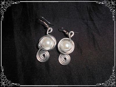 adc3d40b9c39 Pendientes de aluminio plateado con perla...