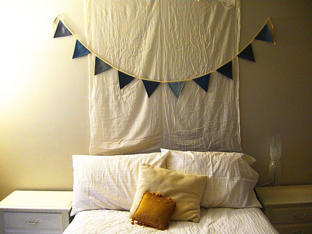 Create a bunting (here's how) with different shades of denim for a cool-looking banner.  Source: Etsy User GoodDenim