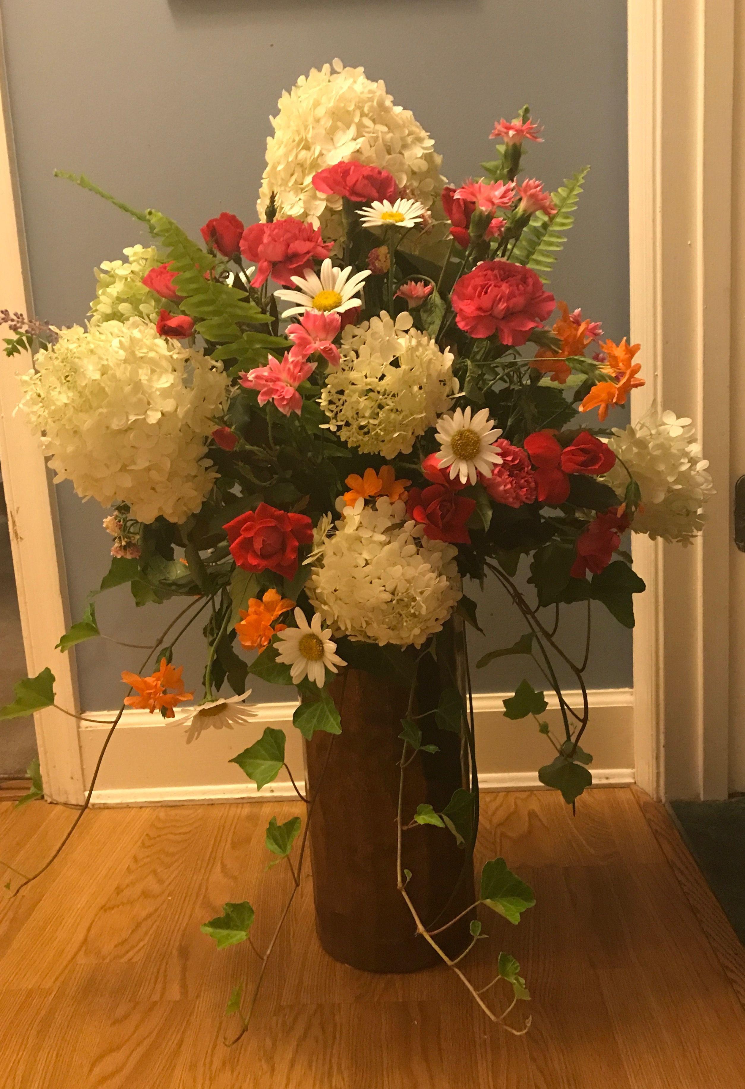 August arrangement white hydrangea daisies roses