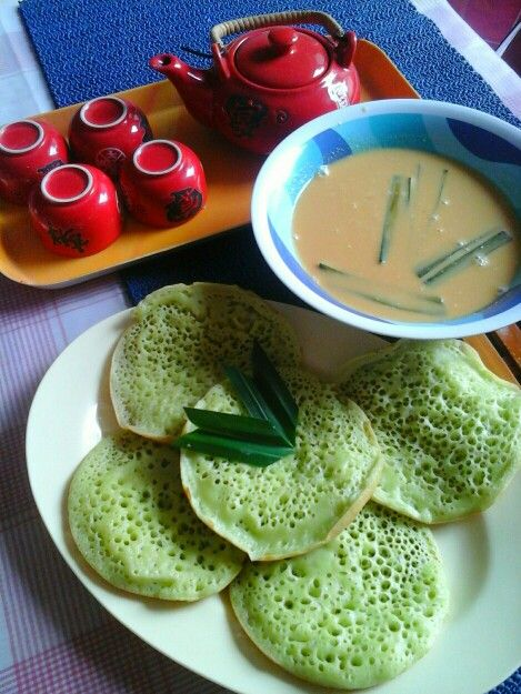 One of Indonesian traditional snacks ,,,called Serabi ,,,eaten with some sweet browned sugar coconut milk sauce