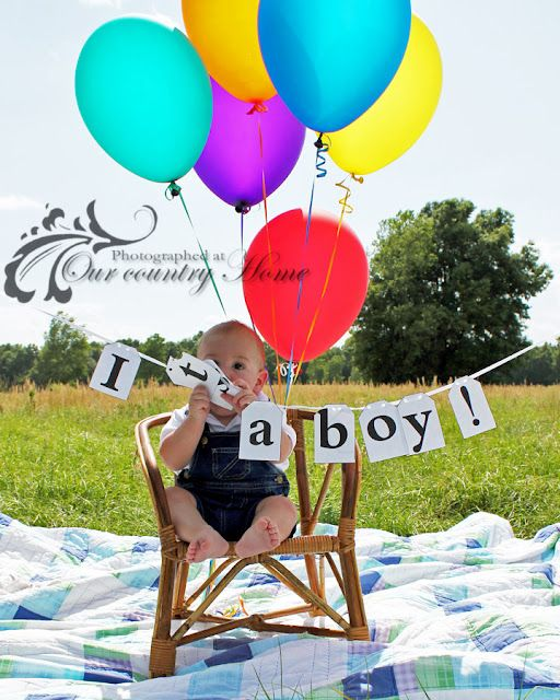 Baby boy and balloons