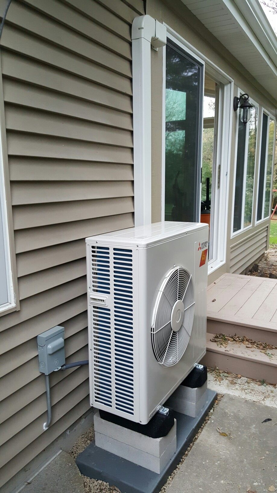 hight resolution of fh18 mitsubishi ductless heating and cooling system installed in a sunroom by a compass heating and air conditioning inc www compassheatingandair com