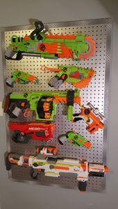 Nerf Gun Rack pegboard painted chrome with diamond plate duck tape boarder. Used small boards on the backside to mount on wall and give enough space to insert pegs. My son LOVES it! - Nerf Gun - Ideas of Nerf Gun #NerfGun