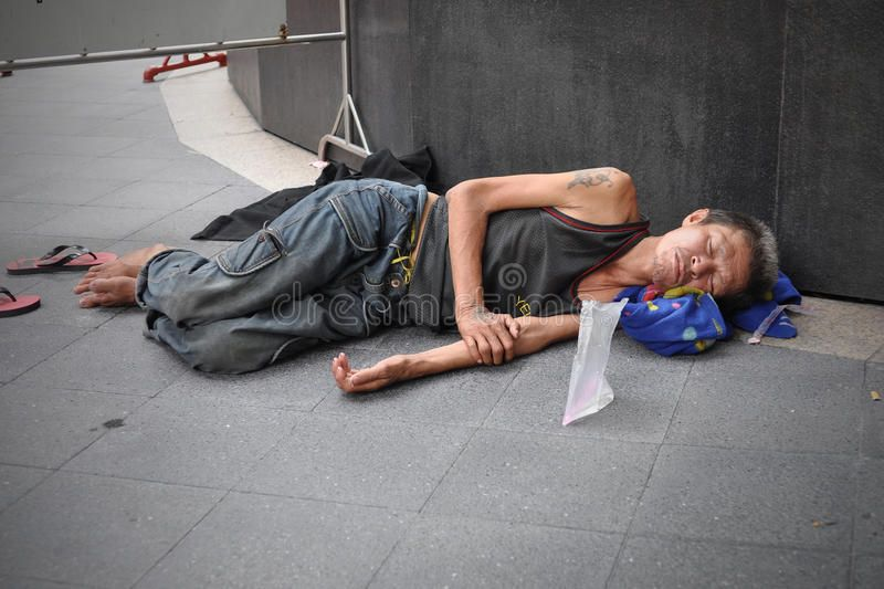 Man sleeps on the street in bangkok a man sleeps on the