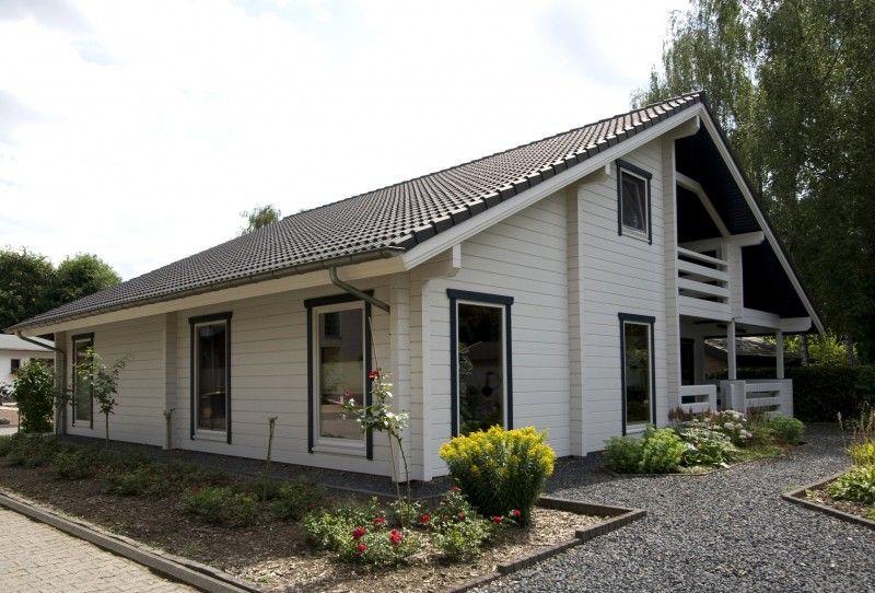 Model nord fins houten huis gebouwd met gelamineerde logs huis pinterest houten huizen - Houten huis ...