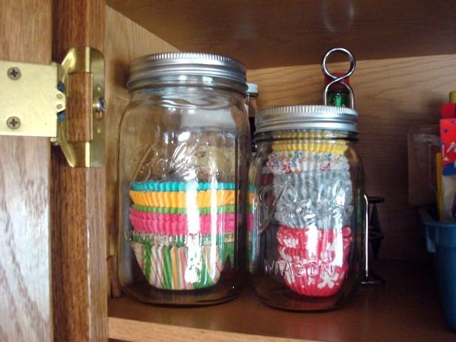 put my mini muffin cupcake liners in a jar, now just need to wash the second jar and I'll put the regular ones in one too, put them in my glass shelves with all the dry pantry items in my glass cabinets- cupcake/muffin papers in mason jars