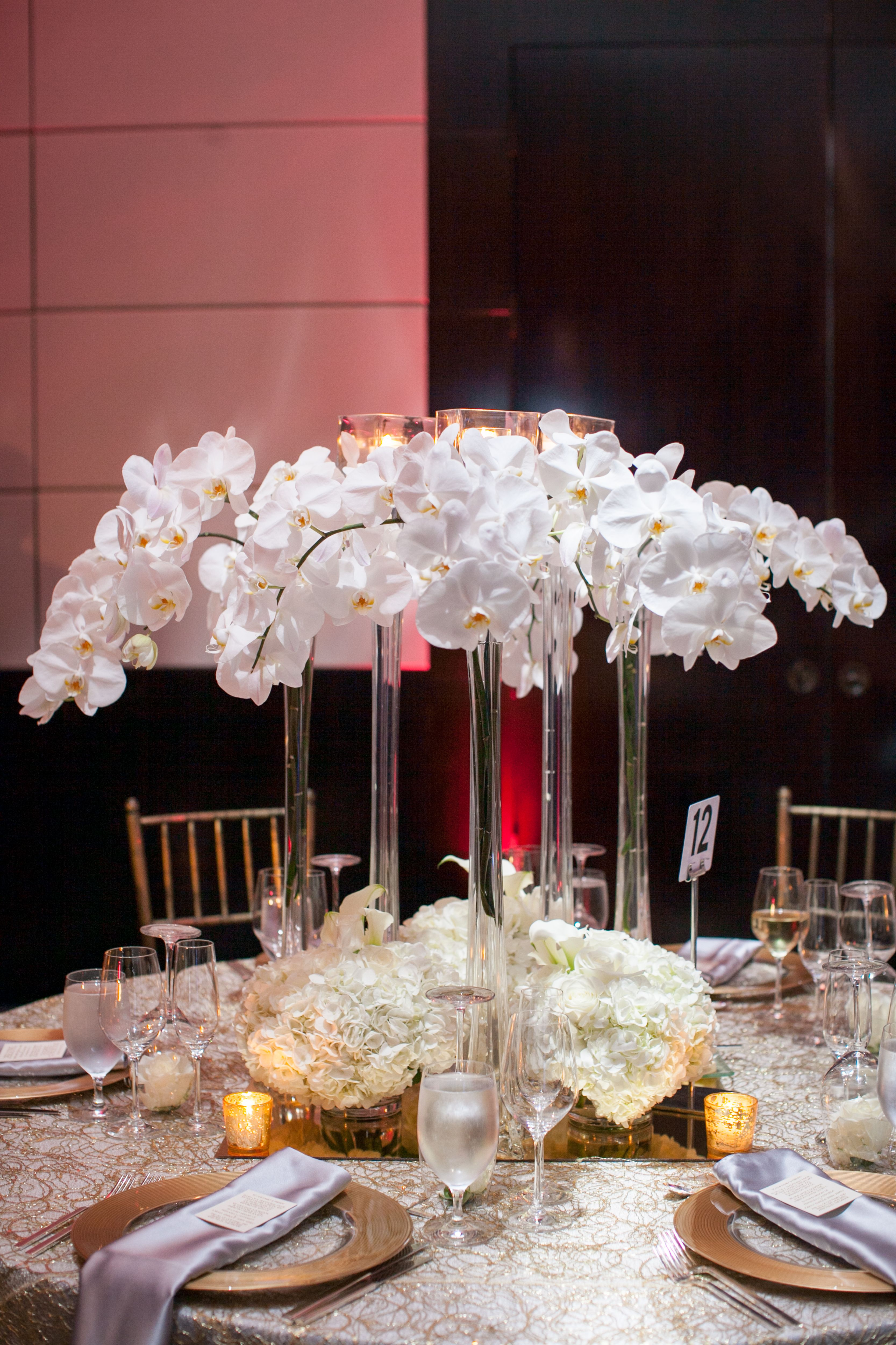 Phalaenopsis Orchids In Tall Thin Vases With Low Lying Floral Accents Designed By Adam Leffel Productions