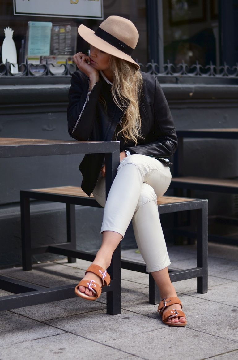 Anouk Yve Is Wearing Black Leather Jacket From Gat Rimon, White Leather Trousers From Ganni, Hat From the Kooples, Shirt From Acne And Sanda...