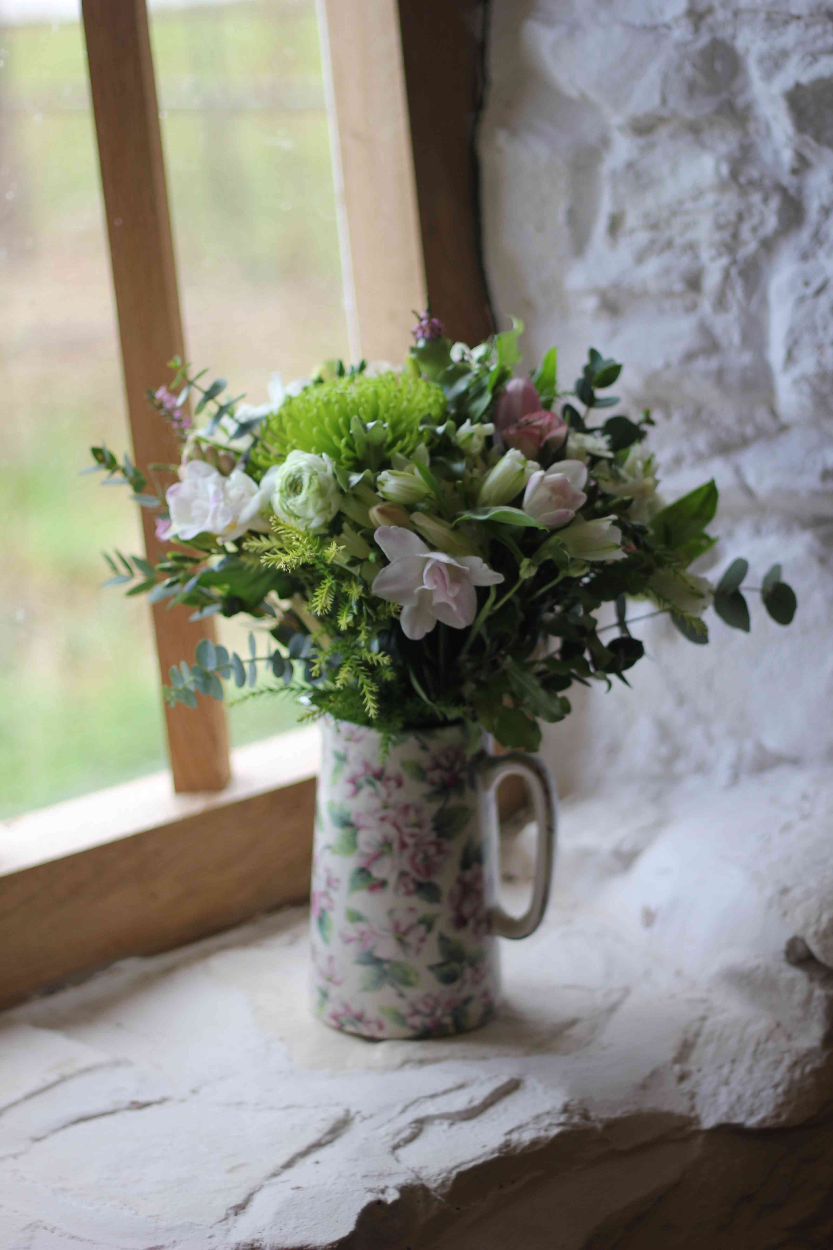 Spring bridal bouquet in one of our pottery jugs flower spring bridal bouquet in one of our pottery jugs izmirmasajfo Choice Image