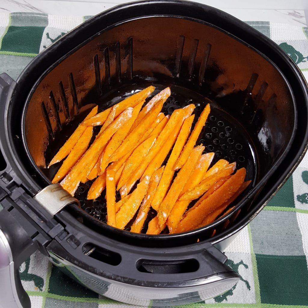 Place Seasoned Sweet Potatoes into Air Fryer Image