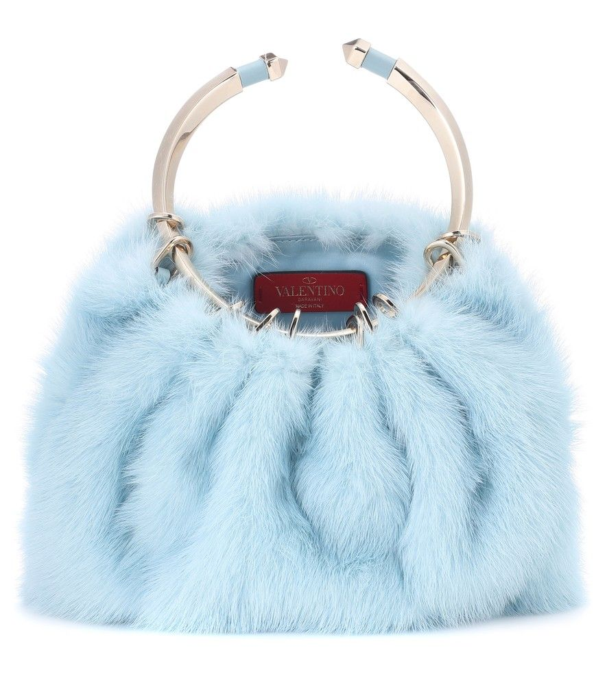 Valentino - Valentino Garavani Bebop Loop mink fur clutch - Valentino Garavani brings a whole new level of decadence to the fashion scene with this mink fur clutch. Crafted in Italy, it features a playful powder blue hue that's matched by the satin lining. We love the modern gold-tone metal handle for a chic contrast. Carry yours next to ball gowns and LBDs alike. seen @ www.mytheresa.com