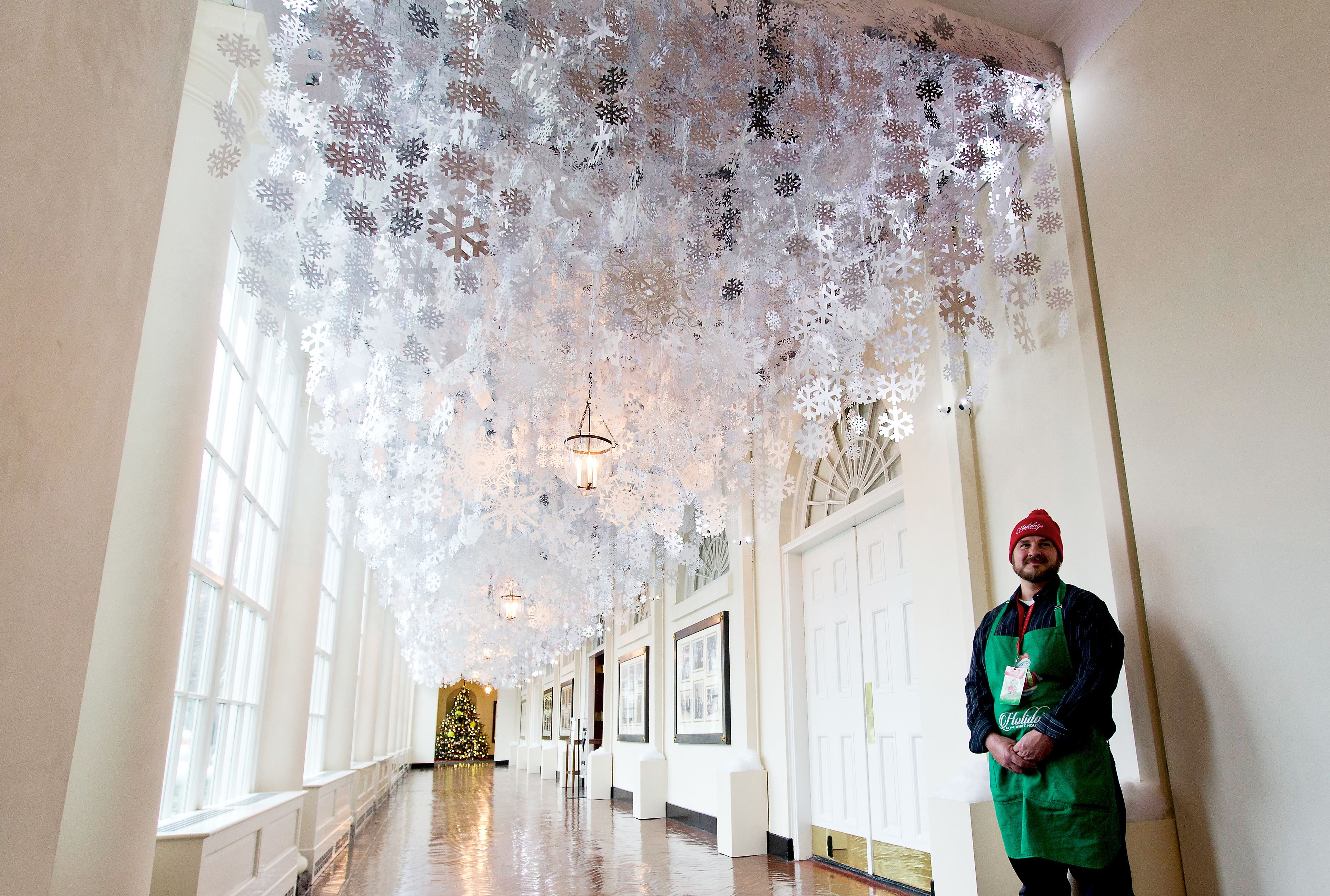 Whitehouse92 7 As Part Of The First Lady Michelle S Reach Higher Initiative A Collection Hand Cut Paper Snowflakes Hang From Ceiling