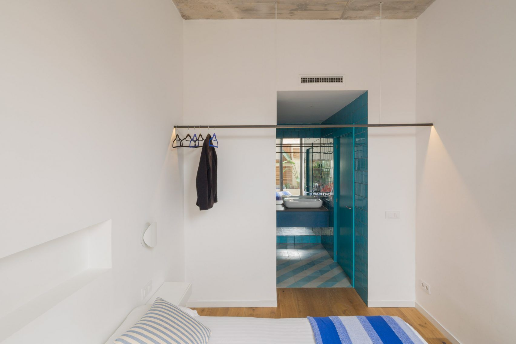 Patterned tiles define rooms in Barcelona bed and breakfast