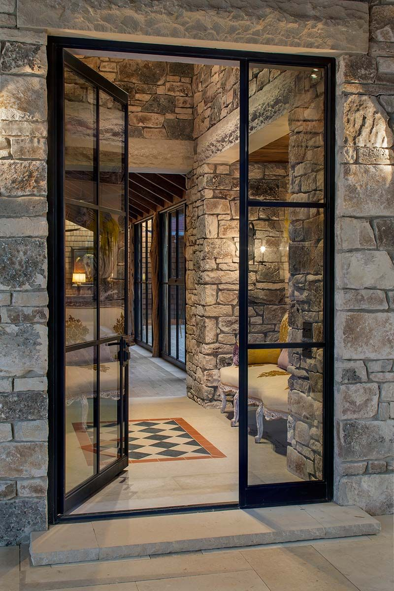 Porte cochere entrance exterior windowsdoors pinterest like the black framed glass doors and like the way the view looks against the natural rock the eden companies windows doors eventshaper